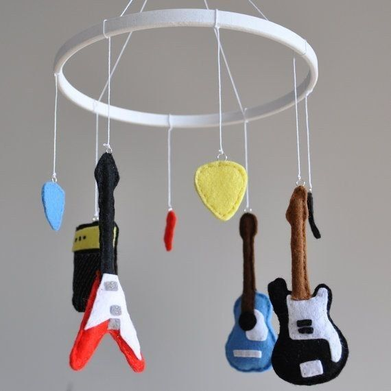 Some kids have animals hanging from their mobile, but yours will have guitars, picks, and amps. | 24 Baby Products Every Music Loving Parent Needs