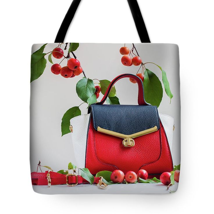 Beautiful Bright Bag And Belt Close, Light Gray Background In Decoration Of Apples Tote Bag by Svetlana Iso.  The tote bag is machine washable, available in three different sizes, and includes a black strap for easy carrying on your shoulder.  All totes are available for worldwide shipping and include a money-back guarantee. #SvetlanaIso #SvetlanaIsoFineArtPhotography #Photography #ArtForHome #InteriorDesign #Bags