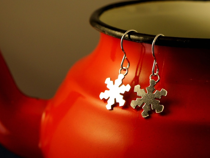 A tiny snowflake to celebrate winter, a grown up piece of festive or seasonal jewellery. Attached to a short sterling silver ear wire.