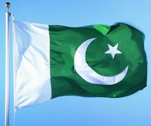The flag of Pakistan. The white strip represents peace and honesty and symbolizes the role of religious minorities. The crescent,star and green background are all traditional symbols of Islam. The green also symbolizes hope, joy and love. The flag was desgined by Muhammad Ali Jinnah and Amiruddin Kidwai