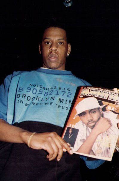 The irony. JiggaWearin a Biggie shirtHolding a Nas magazine pic With Tupac in the caption picture. Please show me a more accidental greatest pic in hip hop ever