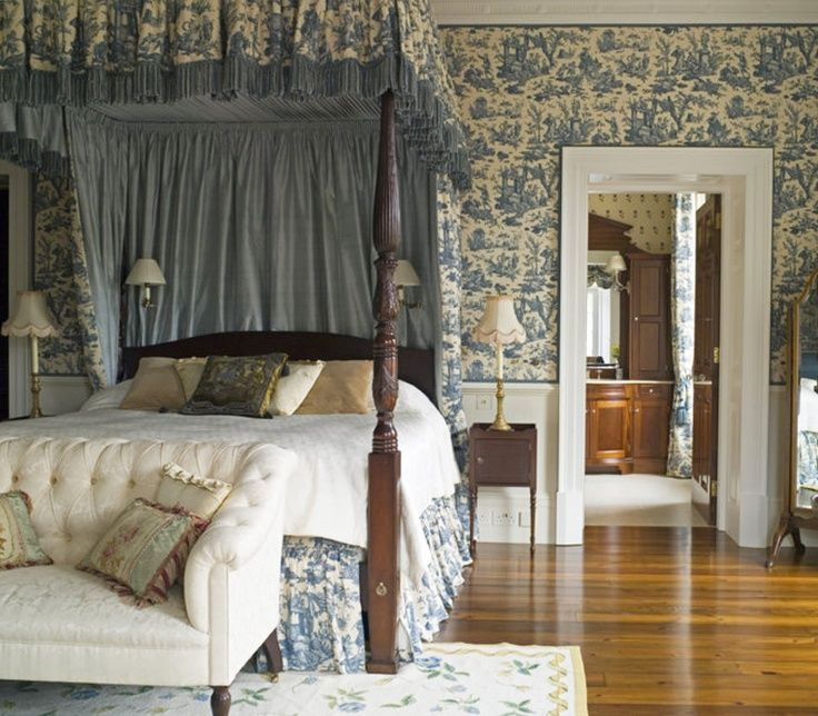 blue & white English bedroom ~ Henrietta Spencer-Churchill design | kind of like this styling with no front bed post curtains but with matching wallpaper to bed curtains/linens!
