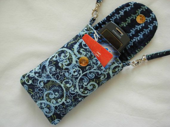 Cell phone holder with shoulder strap
