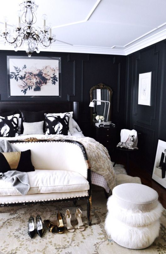 Black lacquered walls + molding + chandelier = Diva GLAM