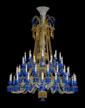 Fine and Monumental Handcrafted Baccarat Full-Lead Crystal Forty-Eight Light Zenith Long Chandelier, designed by Philippe Starck, with colored glass featuring two tiers of graduated arms, the upper tier with sixteen alternating rope twist arms above a lower tier of thirty-two alternating arms, the top portion dressed with faceted fleur-de-lis and spear prisms and streams of beaded chains.