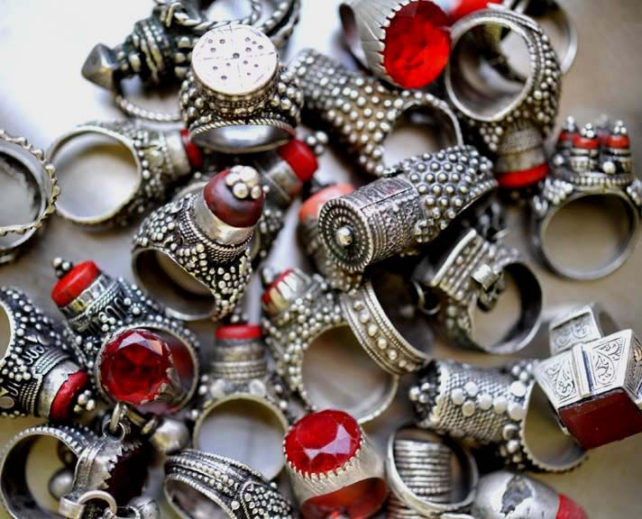 Personal collection of tribal silver and glass rings from Yemen.  Jewish craftsmanship, approximately 70-100 years old.  Talismanic, often worn by Yemeni brides on their left thumb for protection.