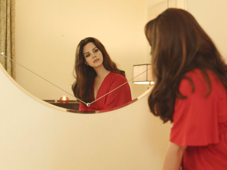 Lana Del Rey in red, looking at her reflection in a mirror // Lana by Jork Weismann for 'Interview Magazine' (2015)