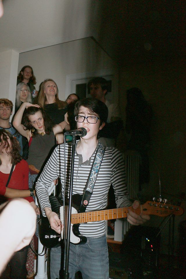 Car Seat Headrest aka Patrick Toledo, who is being wolf-eyed like a raw steak by that girl in the black tanktop.