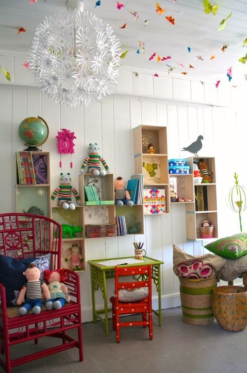 Eclectic Playroom with Chandelier, Hardwood floors, Casbah chair - red, Maskros Pendant Lamp, Cuckoo Clock FUDE1056