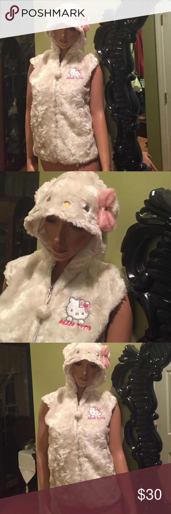 Hello kitty white faux fur vest jacket adult M Hello Kitty white faux fur jacket vest size junior woman M zips in the front- this is hard for me to part with - only worn a few times but rare and super cute. I am just trying to get rid of things I don't wear. Hello Kitty Tops Sweatshirts & Hoodies