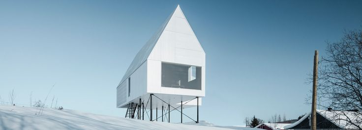 delordinaire elevates high house above snow-covered landscape in quebec