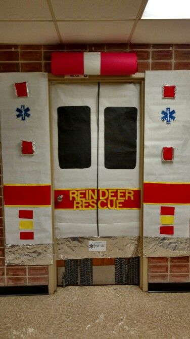 Winter school door ambulance. Used plastic ornament box for cylindrical lights. Door says reindeer rescue, easily interchangeably for other occasions.   Personal touch license plate has last names of tech and nurse.