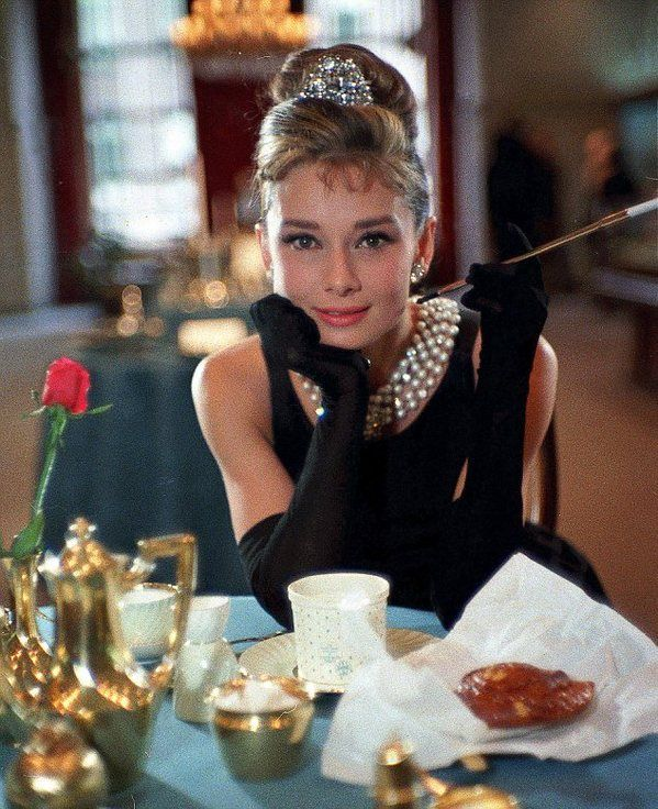 Audrey Hepburn eating breakfast at Tiffany's, of course.
