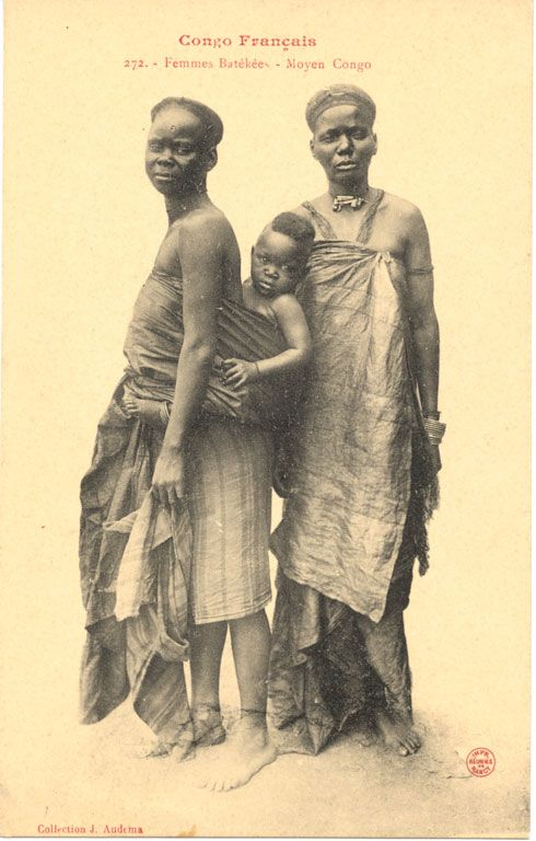 Translated caption reads: ''French Congo. Batékées women - Middle Congo''. Mother carrying a child, older woman on her side. Congo Français. Photograph by J. Audema. ca.1905
