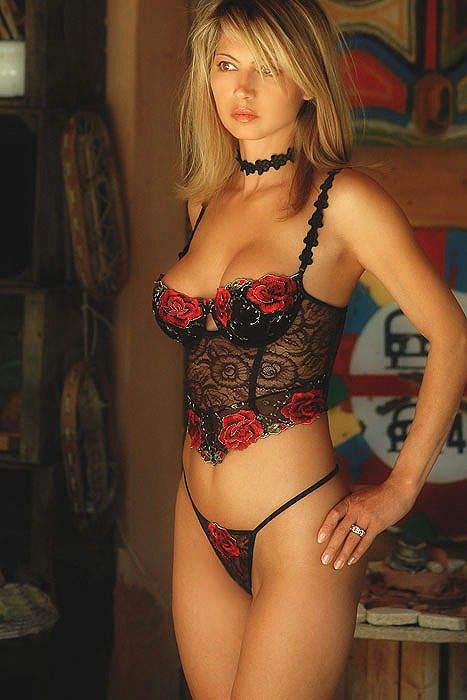 image Stunning lingerie clad bombshell cums on her new toys