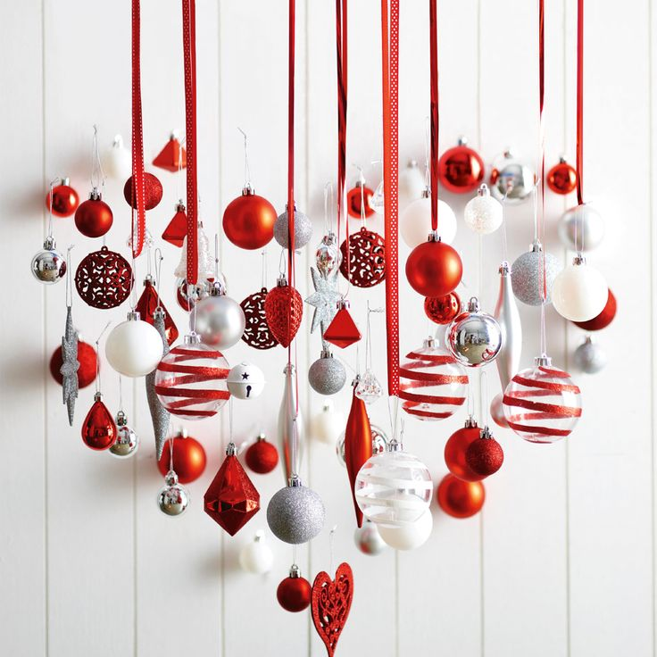 Spread the Christmas spirit in your house! Attach Christmas decoration to coloured ribbon and hang all over the house. #Woolworths #Christmas #Decoration #Inspiration