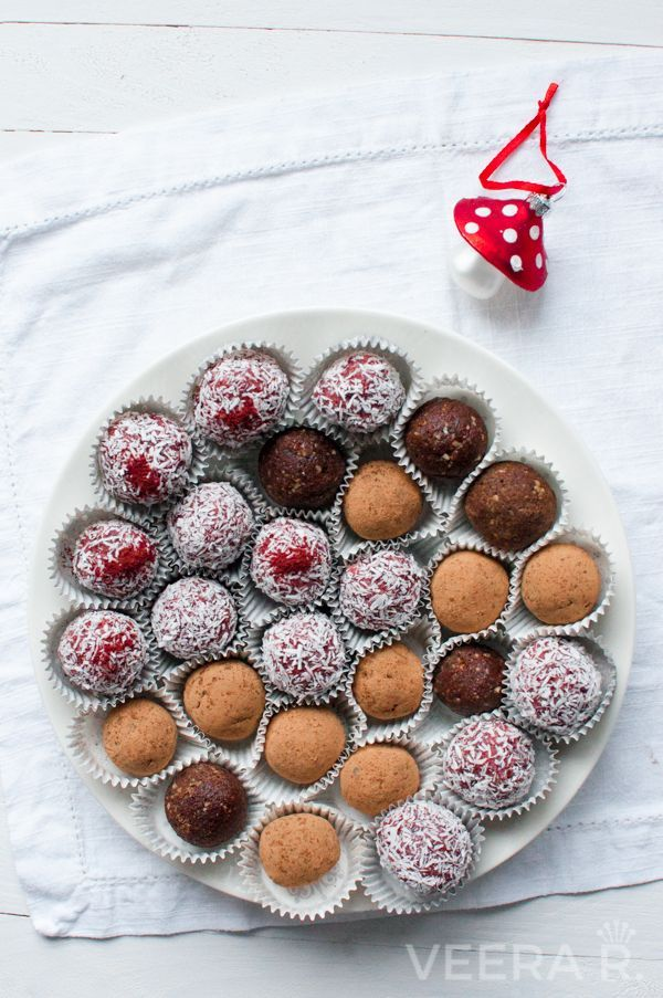 Amazing date truffles made with hazel nuts and raw cacao powder and lingonberries and coconut.
