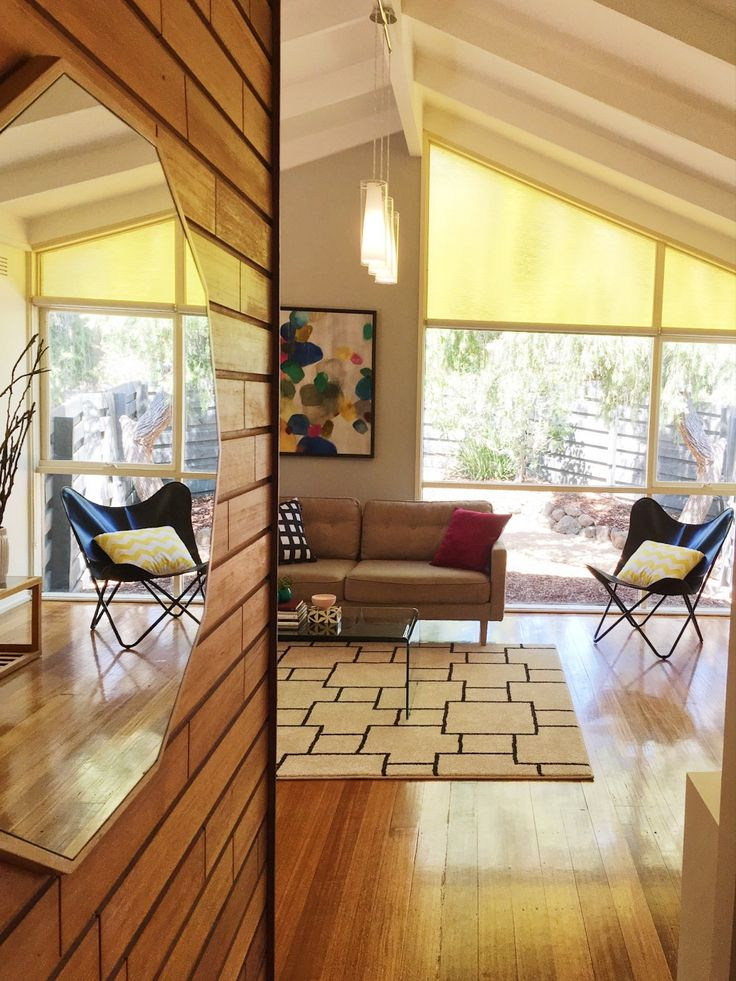 Living room in retro home.  Property styled by Leeder Interiors.