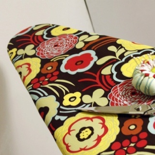 I like this ironing board cover (Etsy) - it's different - very different.
