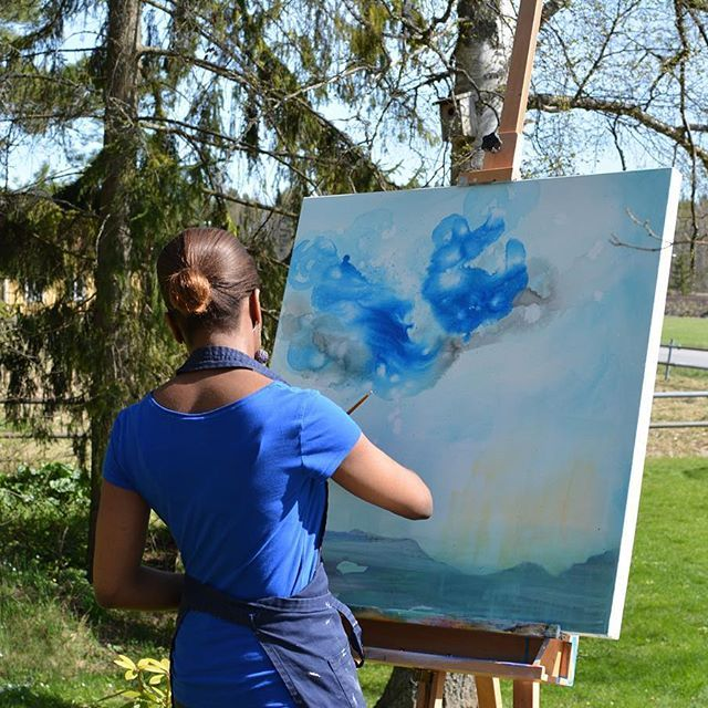 I'm enjoying the sunny weather and painting outdoors inspired by all the lovely clouds in the sky.