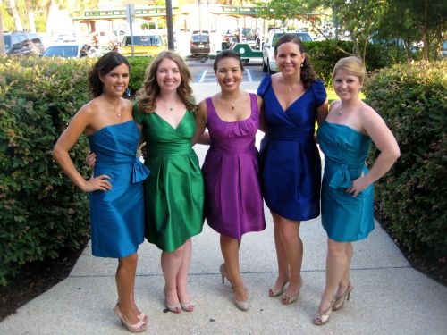 Peacock feather color palette bridesmaid dresses.