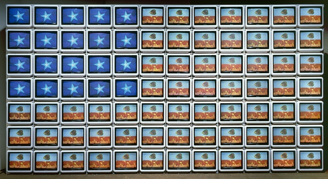 Nam June Paik (South Korea, Seoul, 1932-07-20 - 2006-01-29)   Video Flag Z, 1986  Multi-media; Time Based Media; Powered device, Television sets, videodiscs, videodiscs players, and Plexiglas modular cabinet, Overall: 75 x 138 1/2 x 16 in. (190.5 x 351.79 x 40.64 cm)  Gift of the Art Museum Council (M.86.156.1-.92)  Contemporary Art Department