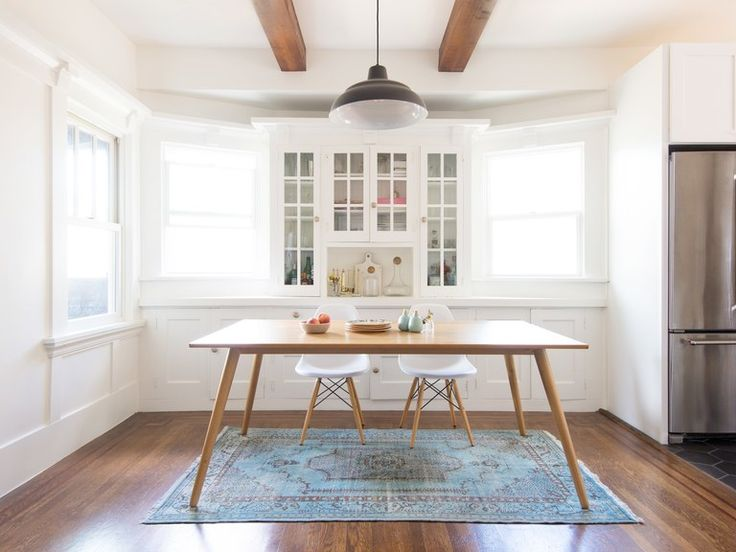 A kitchen featuring a rug from Revival Rugs, an upstart antique carpet company.