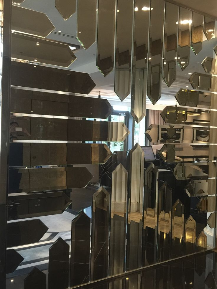 Mirror panelled partition wall.