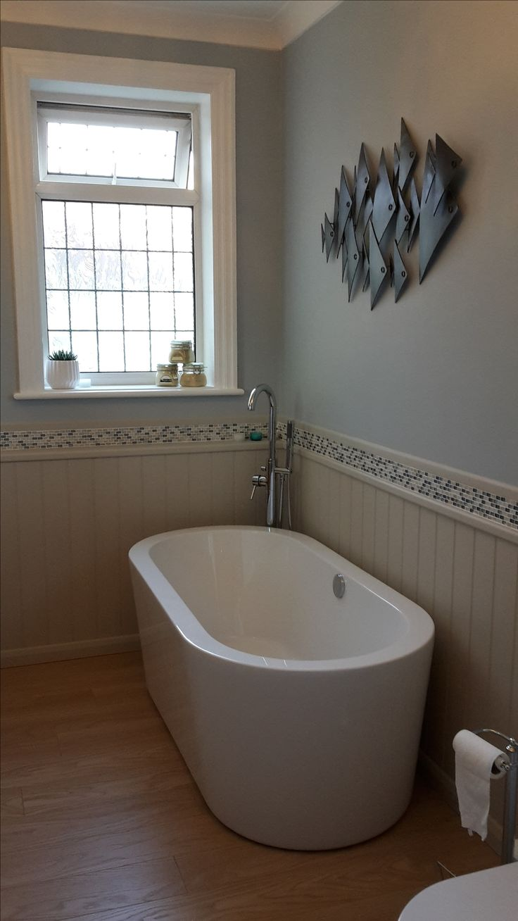 The statement Crescent freestanding bath with Matrix freestanding bath filler tap looks great in our customer's real bathroom.
