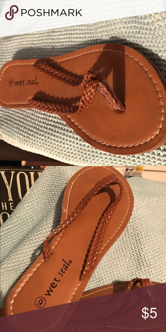 Wet Seal Brown Flip Flops Size 6 Brown braided flip flops from Wet Seal. Size 6. Worn a few times. Wet Seal Shoes Sandals
