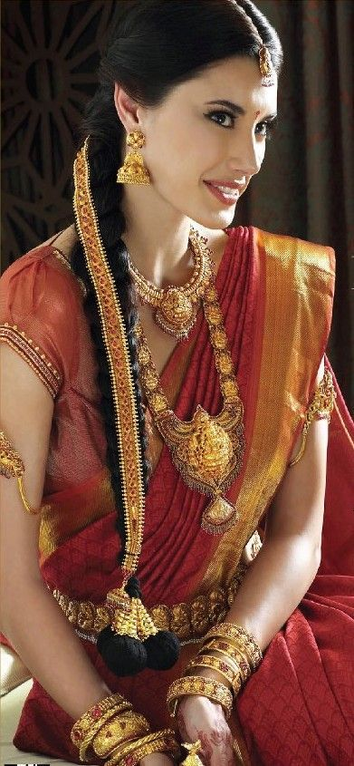This south indian bride is such a treat to look at as she adorns this heavily embroidered silk saree along with traditional temple jewellery pieces.
