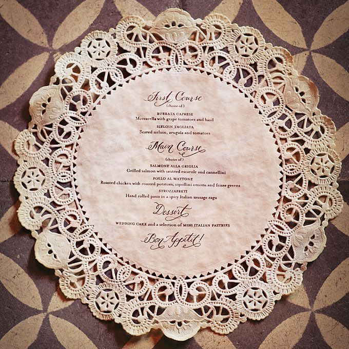 Brides.com: Creative Wedding Menu Displays. Paper DoiliesWhite paper doilies purchased in bulk were stained with tea for a vintage look; after drying, each doily was stamped with the menu text using a custom rubber stamp and then pressed flat with an iron.Custom stamp, Love Jenna Calligraphy