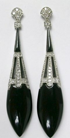 One pair of art deco platinum drop earrings. Two elongated tear drop shaped black onyx. Two triangle cut black onyx pieces. Forty-eight round brilliant cut diamonds (0.44 carats: SI clarity: G-H colour).