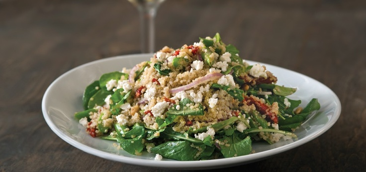 California Pizza Kitchen - new salad with arugula, quinoa, red onion, sun dried tomatoes, asparagus, with a champagne vinaigrette dressing, topped with feta cheese- delicious and healthy!