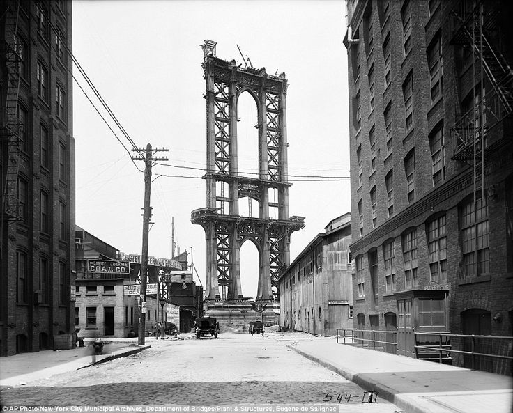 In this June 5, 1908 photo, the Manhattan Bridge is less than a shell, seen from Washington Street. It wouldn't be opened for another 18 months and wouldn't be completed for another four years
