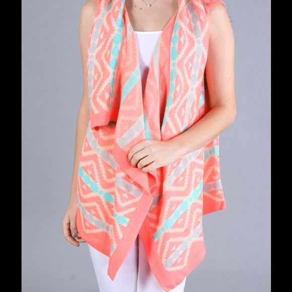 ⚡️ FLASH SALE! ⚡️ TRENDY AZTEC PRINT CARDIGAN!! This trendy Cardigan features an Aztec print in coral, green, & white. Only the coral cardigan is available. Size Medium. Material is made of Acrylic & Mohair, & is so soft! Sizes Small & Large are also available in other listings. No trades or PayPal. Sweaters Cardigans