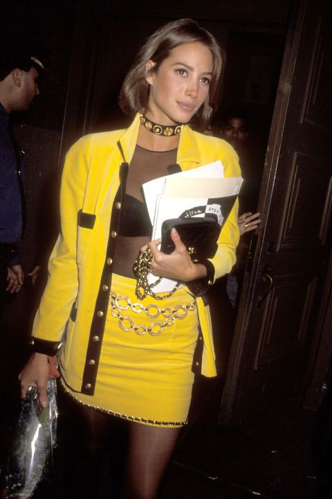 Even ladylike suits get the sultry treatment—thanks to see-through tops—as seen on Chrsity Turlington in our list of 90s bombshell style.