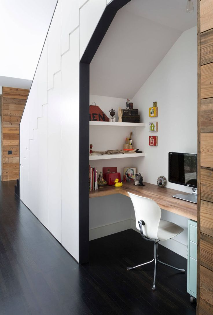 This desk tucked under the stairs features a wrap around desk, two wall mounted shelves, and a small filing cabinet - all the essentials you need for a functional home office. - 10 Small Home Office Ideas -