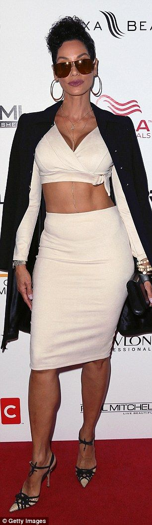 Well cropped: For the preview event, the former wife of Eddie Murphy rocked a high waisted...