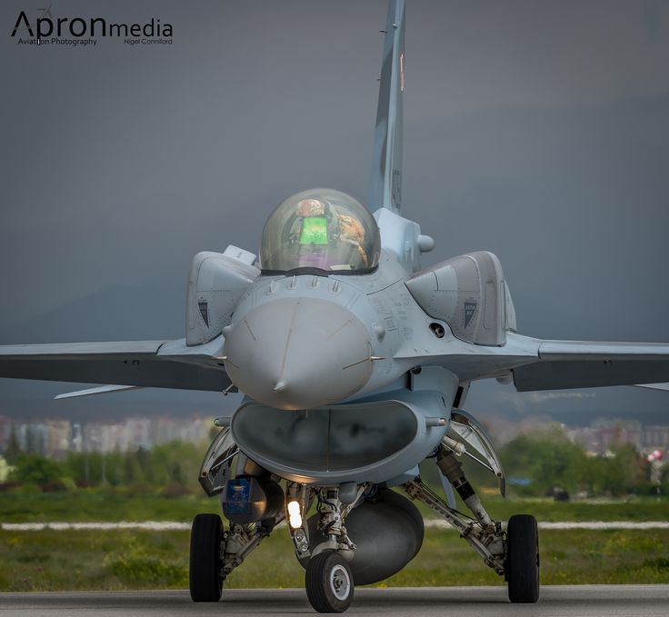 https://flic.kr/p/srBoBA   Polish Air Force F-16C Block 52 4054   Take a deep lung full of damp air, Clouds of mist form in the air intake of the Polish Air Force F-16C Block 52 4054 as he opens up the Pratt & Whitney F100. If you enlarge the photo you can also clearly see the Soft Toy Tiger behind the Pilot and see the visor and oxygen mask with there Tiger covers on.
