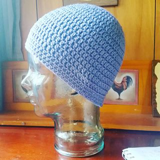 This is a basic dc beanie that can be made in any ww yarn. It is easily customized by adding appliques or by changing colors to create striping. Great beginner hat pattern!