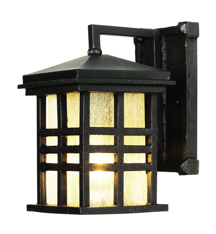 Rustic mission style outdoor coach light perfect for rustic cabin décor. Square lantern with seeded glass in three bar frame with angled roof. Finish: Black Height: 10'' Width: 8'' Depth: 6'' Bulb: 1-