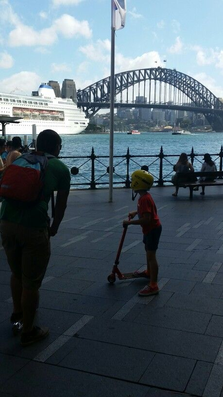 Sydney Harbour Bridge.  Brodie enjoying the big walk day on his scooter.  Making travelling with kids fun for all