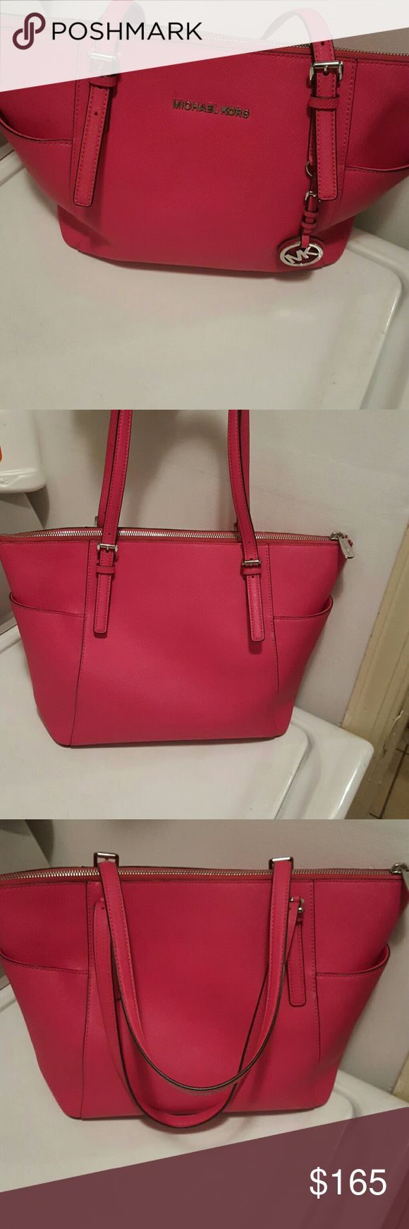 Michael Kors Authentic Pink Purse No Coupon accept Used condition.  Outside is almost like new.  Inside does have some stains but no tears.  NO COUPONS FROM PREVIOUS BUYERS ACCEPTED ON THIS ITEM, THANKS!! MAKE ME AN OFFER!! Michael Kors Bags