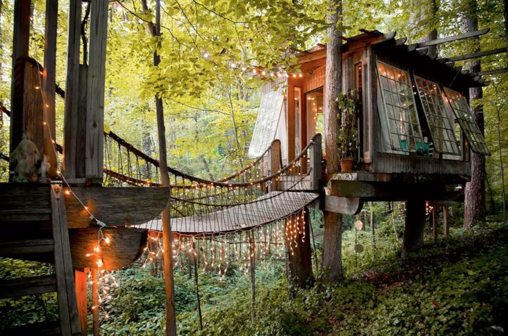 Tread the rope-bridges above the foliage and land in your cozy fairytale treehouse lit with starry strings of lights fit for a forest fairy or ewok.
