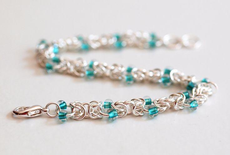 Teal Beaded Chainmaille Bracelet, Byzantine Chainmaille Bracelet, Byzantine Chainmail, Chain Mail Jewelry, Beaded Link Bracelet by PJsPrettys on Etsy https://www.etsy.com/listing/156832932/teal-beaded-chainmaille-bracelet