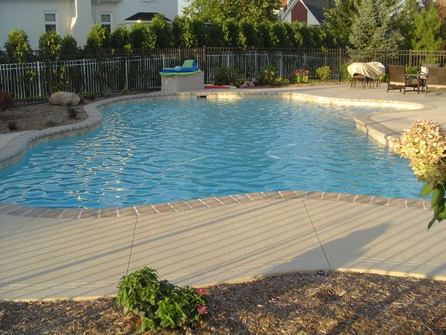 Concrete Pool Ideas this decorative concrete pool deck stayed with concretes natural coloring and also included subtle texturing Find This Pin And More On Pool Ideas Concrete