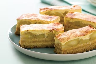 Use a clever shortcut to create these baked golden slices filled with warm apple, sour cream and cinnamon.
