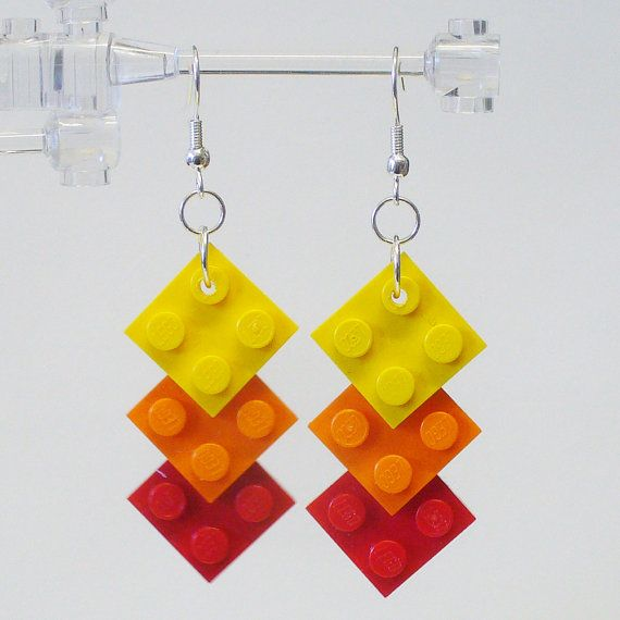 More lego earrings... I want to go all out and make these. I think you could buy some cheap earrings and use a glue gun instead of drilling...