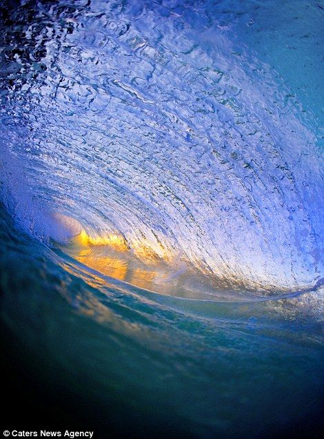 Amazing pictures from inside breaking waves....  The breath-taking images show the split-second in which each one breaks and crashes on to the sand